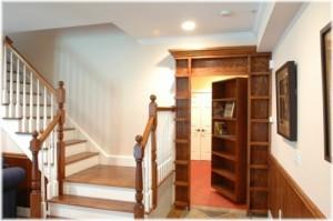 Hidden swing-in bookshelf door open