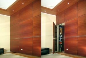 Hidden door opens in office wall