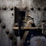 Old secure steel door locking mechanism