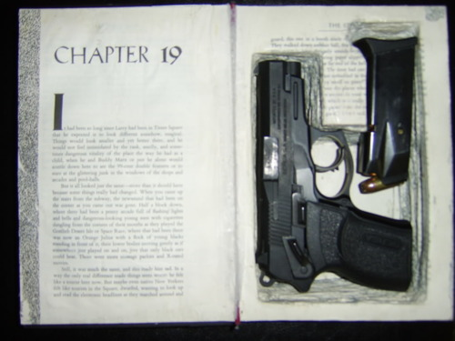 Secret hollow book compartment conceals pistol and magazine