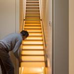 Secret passage hidden under stairs
