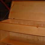 Bookcase with hidden top compartment