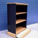 Bookcase with secret drawer compartment in bottom