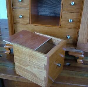 Secret compartment in drawer false bottom