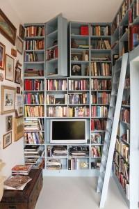 Secret bookcase door in library