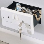 Hidden electrical outlet wall safe