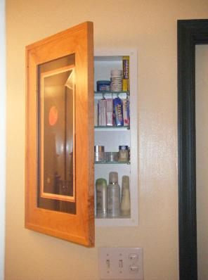 Concealed bathroom cabinet behind picture frame door - Bathroom mirror with hidden storage ...