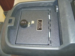Hidden lockable secure center console vault safe