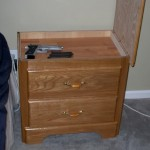 Lift top on nightstand to reveal hidden stash compartment