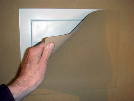 Hidden wall safe behind paintable magnetic cover