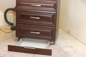 Cabinet with secret compartment drawer in toekick