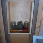 Custom hidden stash compartment built into the wall