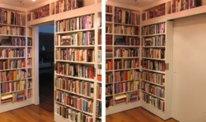Hidden bookcase door passage reveals secret room