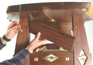 Hidden compartment in wooden table furniture