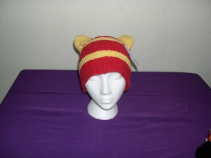 Hidden stash compartments in ears of knitted hat