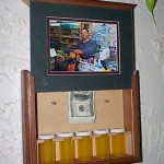 Slide open picture frame conceals secret containers