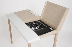 Desk furniture with hidden compartments