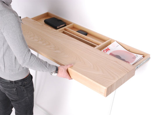 This shelf slides out to reveal several internal secret compartments ...