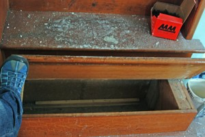 Stair tread lifts up to reveal hidden stash compartment
