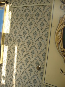 Wall papered door at Stoke Rochford Hall