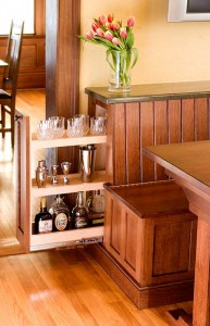 Slide-out compartment in breakfast nook bench