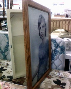 Old Medicine Cabinet Hidden by Picture Frame