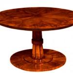 Tilt-top table with hidden inner compartment