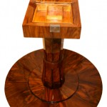 Tilt top table reveals secret compartment in furniture
