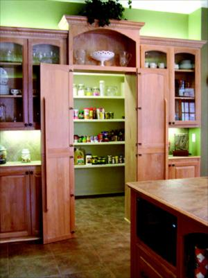 Doors of pantry open to reveal walk-in pantry