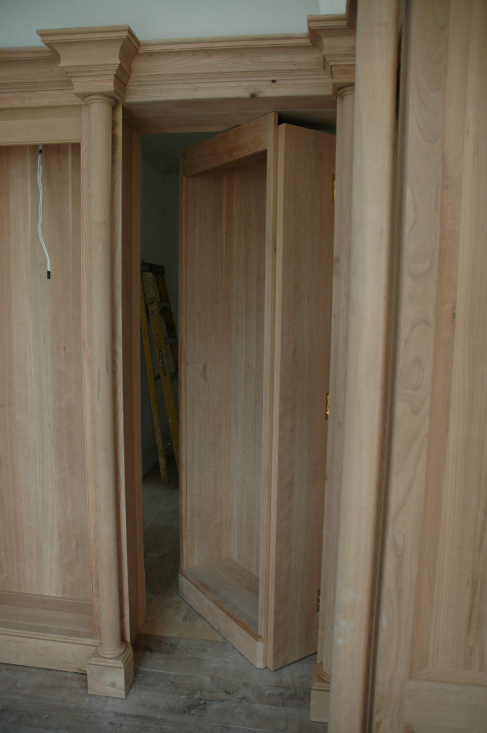 Hidden moving bookshelf door - swing-in