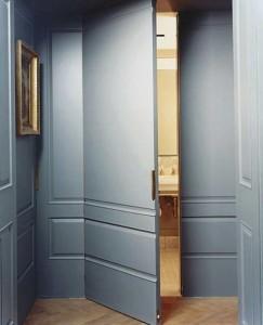 Hidden door behind wall panel