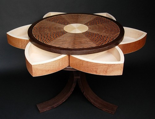 Hidden swing-out compartments in this Lotus Table