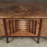 Desk with pipe organ played by closing drawers