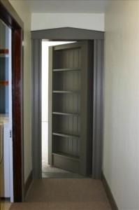 Secret passage behind bookcase door