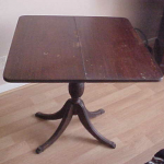 Folding table with secret compartment below