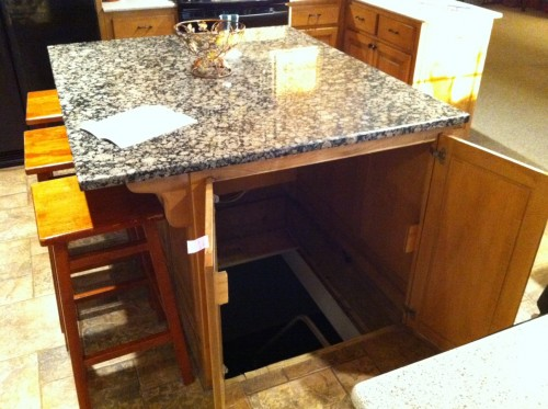 Secret trap door in kitchen island leads to underground shelter