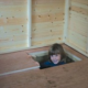 Lift up trap door in floor of playhouse