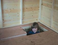 Lift up trap door in floor of playhouse