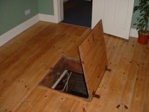 Hidden trap door in home floor