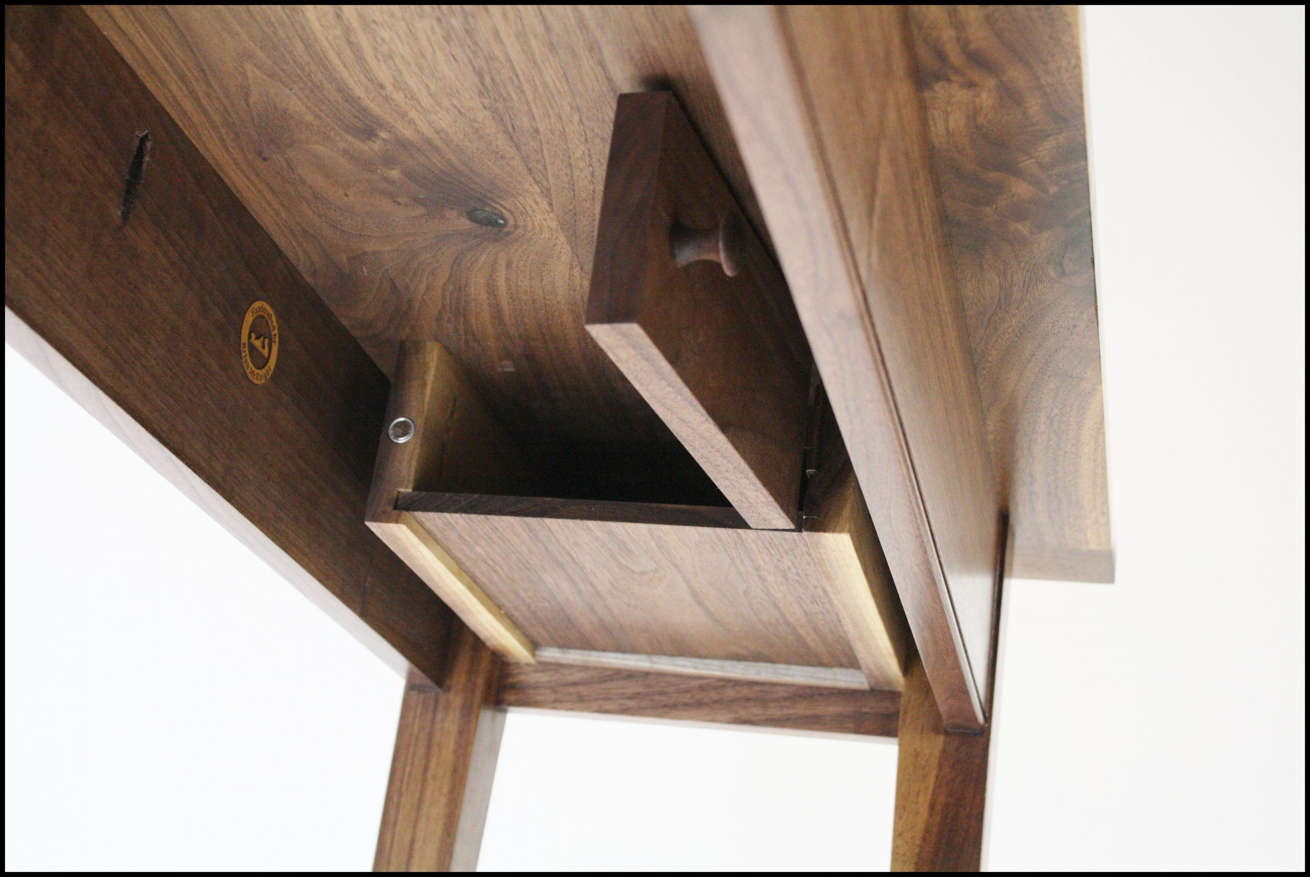 Hidden stash box under console table