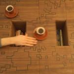 Sliding blocks reveal hidden storage compartments