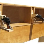Bed headboard with secret pistol compartments