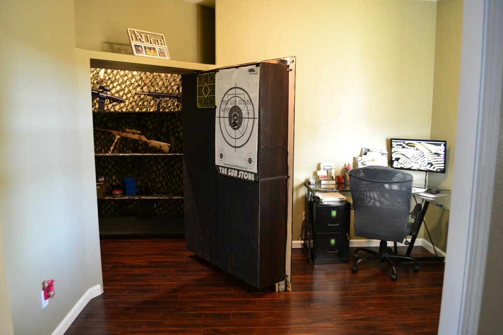 Secret bookshelf door opens to gun storage stashvault for Garage safe room
