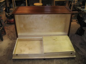 Fold down compartment in custom dresser