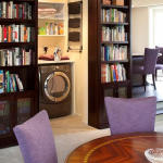Hidden Bookcase Door Reveals Laundry Room