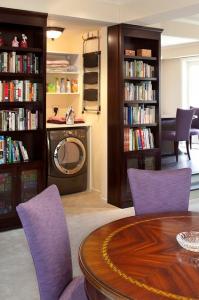 Hidden Bookcase Door Reveals Laundry Room