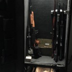 Soda pop machine converted to rifle safe