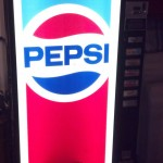Soda pop machine with firearms inside