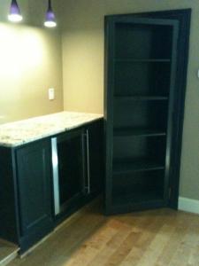 Media Closet with Hidden Bookcase Entrance