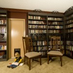 Bookcase Slides to the Side to Reveal Hidden Door